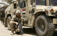 American Soldier by Iraqi Truck