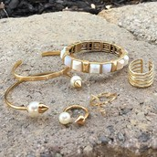 Gold arm party and rings