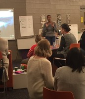 AAA Teachers Discussing Diversity During Cultural Cafe Faculty Meeting
