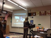 Mrs. Brunot answering Skype call from Jay Heinrichs.