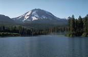 Lassen Volcanic National Park is home to a HUGE volcano. It is called Lassen Peak.