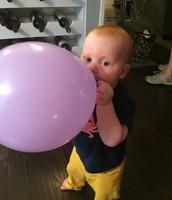 He loves balloons!