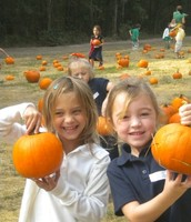 Kayla and Hannah showing the pumpkins from the pumpkin patch!