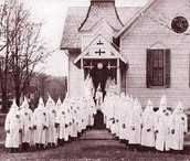 KKK Standing outside a church