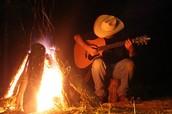 Listen to local musicians around the campfire