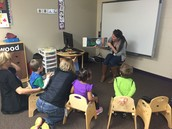 Ms. Darian capturing her students attention with a read aloud