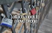Attach a lock to a love bridge
