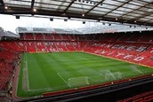 Old Trafford is a soccer stadium, home of Manchester United F.C.