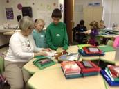 The fabulous Mrs. Schwartz helping students