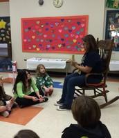 Keyla reads to kids for literacy night.