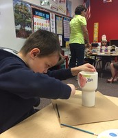 Students in Mrs. Gavina's class paint pottery for Mother's Day.