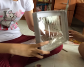 Tightening the clear plastic sheet