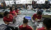 Collage Students and younger working at one of many of Sony's factories