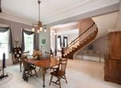 Formal Dining with circle staircase.