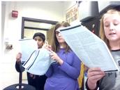 Sadie, Zoe, and Daanish going over the script