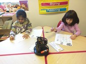 Mariam and Safa working on their letters
