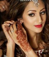 Brides get henna tattoos on their wedding day(s)