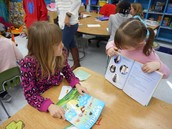 Reading Buddies: K student reading to a second grader