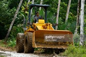 Bulldozer clearing out the environment