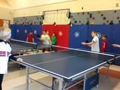 boys turn to play ping pong