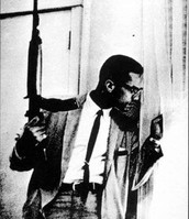 Malcolm X Hides From the Police With His Rifle