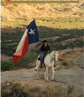 Cowboy with Texas Flag