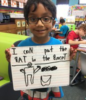 Using our spelling words in a sentence.
