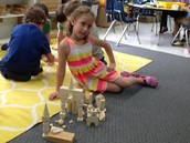 One of our young architects displaying her building.