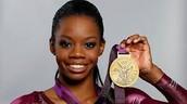 Gabby Douglas Holding Her Gold Medal