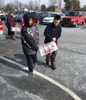 Students help to load trucks