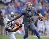 university of Kansas quarterback stiff arms deffender