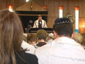 A man leads the service at a synagogue