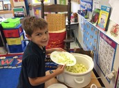 Adding our apples to the applesauce!