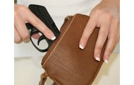 a concealed handgun stashed in a small bag
