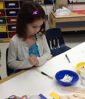 Working on making puppets with posicle sticks.