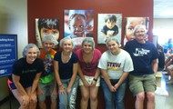 Serving up bagged meals at Feed My Starving Children