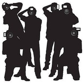 A Silhouette  of paparazzi taking pictures.