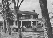 Members of McLean's family sitting on the porch.