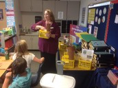 Mrs. Turner showing her Native American Prediction Clue Boxes
