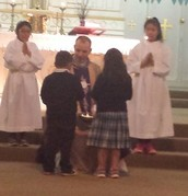 Father Wichert Receives the Gifts from some Little Ones...