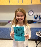 Izzy's classmates voted her as Student of the Month!