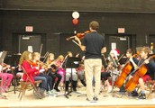 Evergreen's Orchestra Performs at Sing-Along