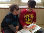 Ian reading to his buddy
