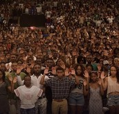 Students at Howard University Holding Their Hands Up