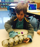 Look at Oliver make 6 on a tens frame!  This is an AWESOME way to build number sense.