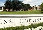 What is the official Johns Hopkins University motto?