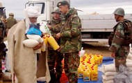 Military giving food to Afghanistan camps with the winter aid