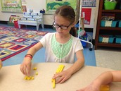 Julia making numbers using rods and units.