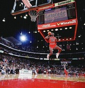 Jordan jumping from the free throw line and dunks it.