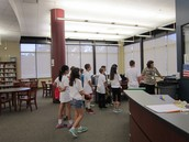 Sixth graders tour the library.